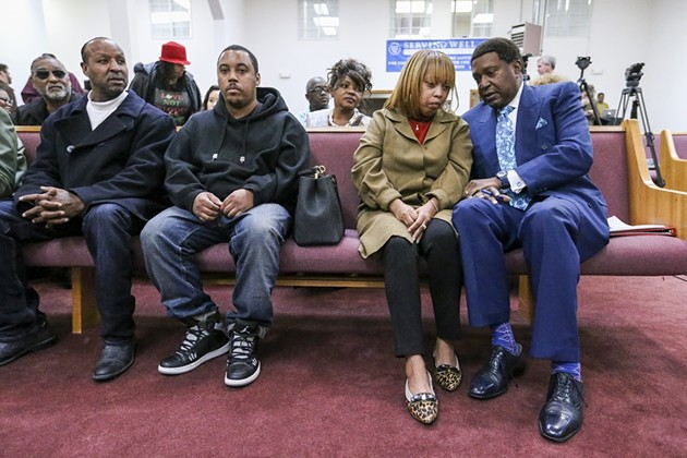 John L. Burris, far right, speaks to Gwendolyn Woods, Mario Woods's mother, before the start of a press conference on Martin Luther King, Jr. Day. - MIKE KOOZMIN/SF EXAMINER