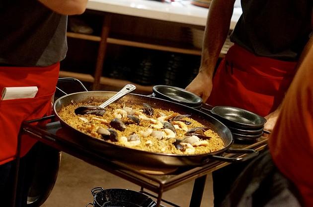 Paella comes table side. - BETH THOMAS