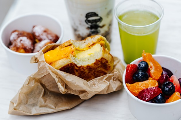 Brekkie: Egg in the Hole, fruit cup, green juice, fruit and yogurt, French toast holes - AUDREY MA