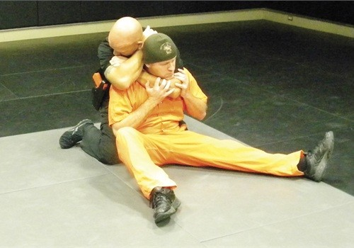 The cartoid restraint - POLICE MAGAZINE