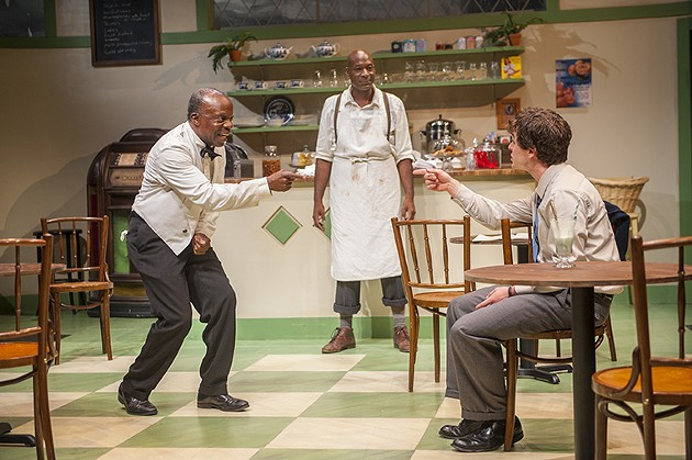 Hally (r. Andrew Humann) chats with Willie (l. Adrian Roberts) after school while Sam (c. L. Peter Callender) prepares his lunch in Aurora Theatre Company's Master Harold…and the boys - DAVID ALLEN