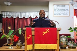 GABRIELLE LURIE - The Rev. Julius K. Magee II gives a sermon at the Rock of Ages Baptist Church in the Bayview.