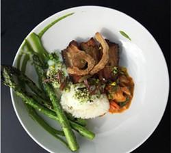 'AINA - Spring asparagus with kalua, pork belly, kimchi, and poached eggs.