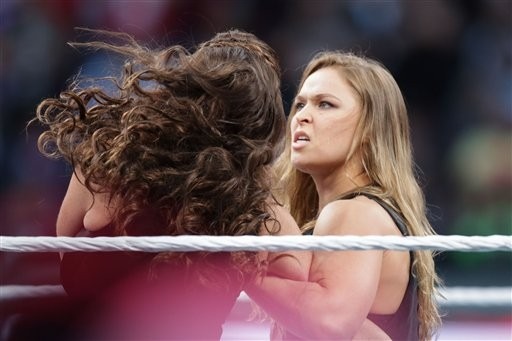 UFC fighter Ronda Rousey makes a surprise appearance at WrestleMania 31 on Sunday. - DON FERIA/AP IMAGES FOR WWE