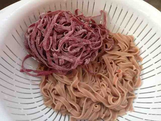 Uncooked and cooked beet pasta by Berkeley Bowl. - TAMARA PALMER