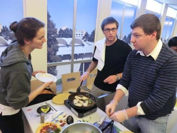 USF students Bethany Goodrich, Adam Lawicki, and Travis Blackburn channel their inner Emeril. - ALEX HOCHMAN