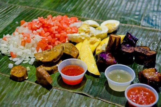 Vegetables and salted eggs on House of Sisig's kamayan platter. - GIL RIEGO, JR.