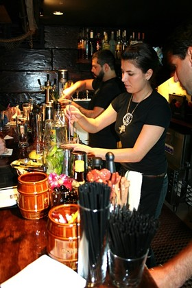 Veteran mixologist Jackie Patterson concocting one of the elaborate drinks. - C. ALBURGER