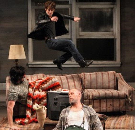 Vince's (Patrick Alparone - in air) homecoming is not what he hoped for in Sam Shepard's Buried Child. Also pictured are Bradley (Patrick Kelly Jones - on couch) and Dodge (Rod Gnapp - foreground). - PHOTO: JENNIFER REILEY