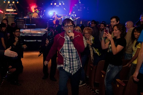Weezer's Rivers Cuomo sure loved to walk up the aisles last night at the Nob Hill Masonic Center. - CHRISTOPHER VICTORIO