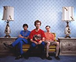 AARON  RUELL - We're a Happy Family: Uncle Rico (Jon Gries), - Napoleon (Jon Heder), and Kip (Aaron Ruell) make - geek chic.