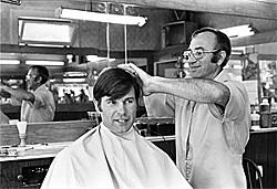 DENNIS DESILVA - White gets a haircut at a Visitacion Valley barbershop.