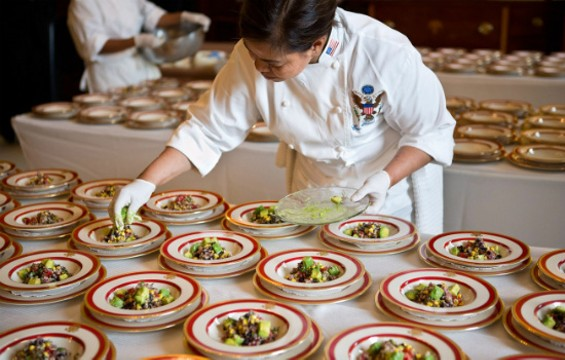 White House Executive Chef Cris Comerford plates Quinoa Black Bean and Corn Salad in the Old Family Dining Room of the White House. - WHITE HOUSE/SONYA N. HEBERT