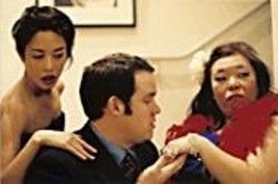 """SEAN  LIM - White Snide: Richard Saugus (Danny Wolohan) with - his two """"props"""" (Pearl Wong, left, and Suz Takeda)."""