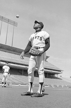 AP PHOTO - Willie Mays, seen here in 1970, may be distracted by that boy climbing on the power cord.