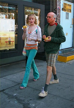 Winsome Mississippi belle (Evan Rachel Wood) charms smug nudnik (Larry David).