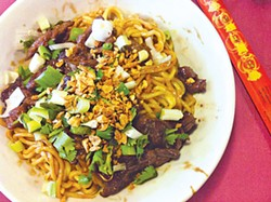OMAR MAMOON - Yamo's house noodles with beef are a study in simplicity.