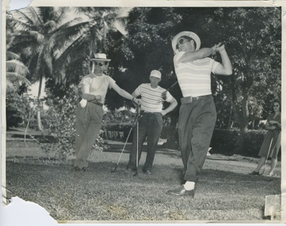 "Yankees golfing, 1947. Phil Rizzuto (right) takes a swing as Rugger Ardizoia (left) jokingly makes the Italian ""corna"" gesture, believed to bring bad luck"