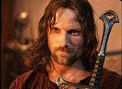 Yes, He Smiles Sometimes: Viggo - Mortensen plays the brooding, hunky king.