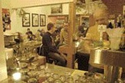 ANTHONY  PIDGEON - You Will Eat, and You Will Like It: Walzwerk's - eccentric thrift-shop décor and photos of Marx, - Engels, and Lenin contribute to the East German - illusion.