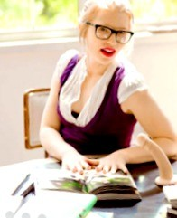 Young looking a little more demure as a sex educator, complete with glasses. And a dildo.