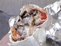 JOHN BIRDSALL - Zaytoon's lamb shawerma, with rotisserie lamb, broiled tomatoes, onions, and tahini.