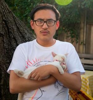 Zum co-founder George Chen, with kitty cat. - SEAN GARRISON