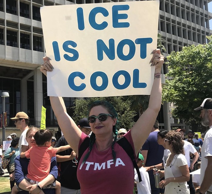 Two Pieces of Inspired Signage at Families Belong Together March in LA