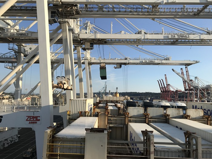 Flying cows!! Animals ship in livestock containers. (Holes allows for breathing, Thompson says.) But when the time comes to remove the containers from the boat, the cranes lift the livestock containers off the ship just like any other cargo.