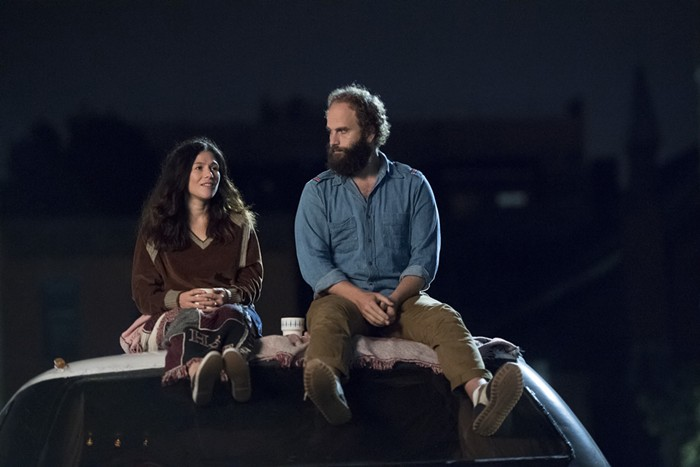 Beth and The Guy on top of the RV she gifts him