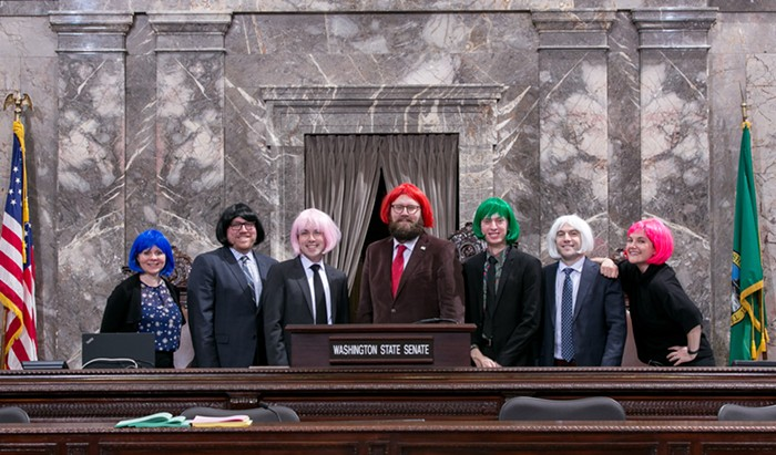 Senate Majority Floor Leader Marko Liias (red wig) and his staff in the Senate chamber.