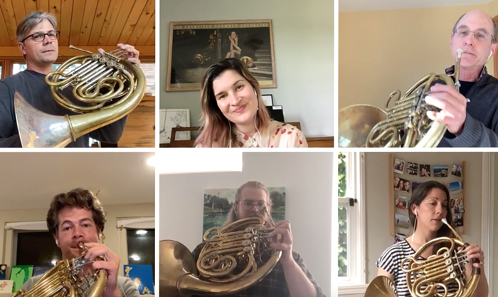 Danielle Kuhlmann, in the top center, usually plays French horn, but this morning she sings for us.