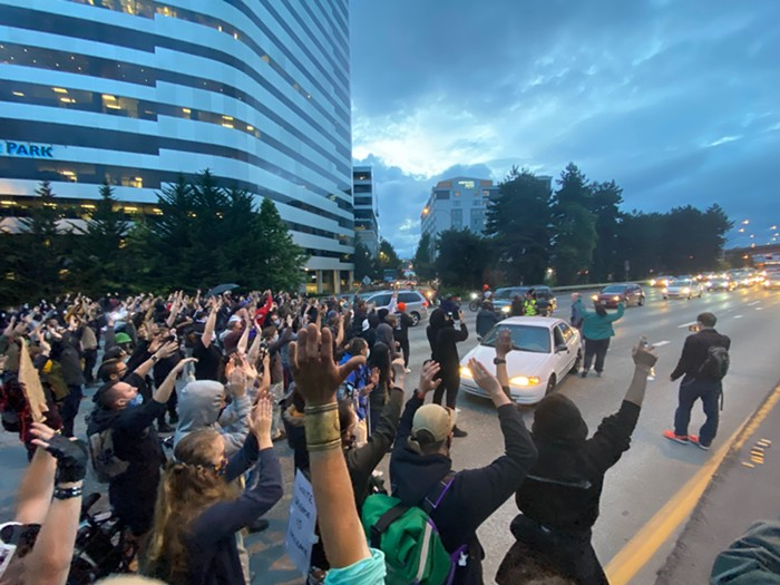 People got out of their cars and joined demonstrators as they blocked traffic on I-5 for five minutes.