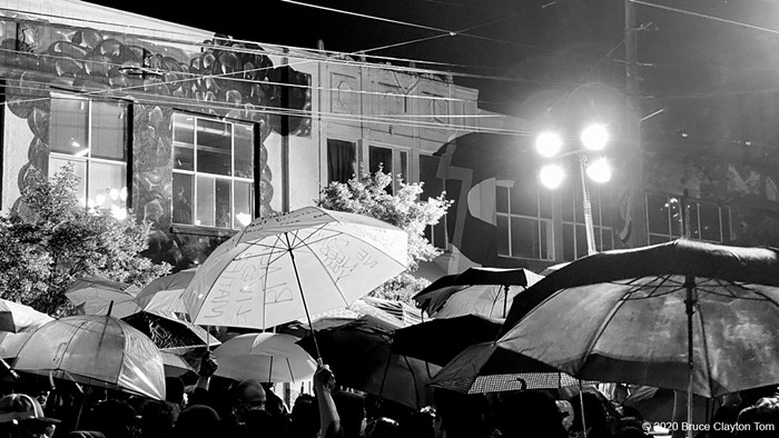 The umbrellas on the front line after SPD switched on their large lights.