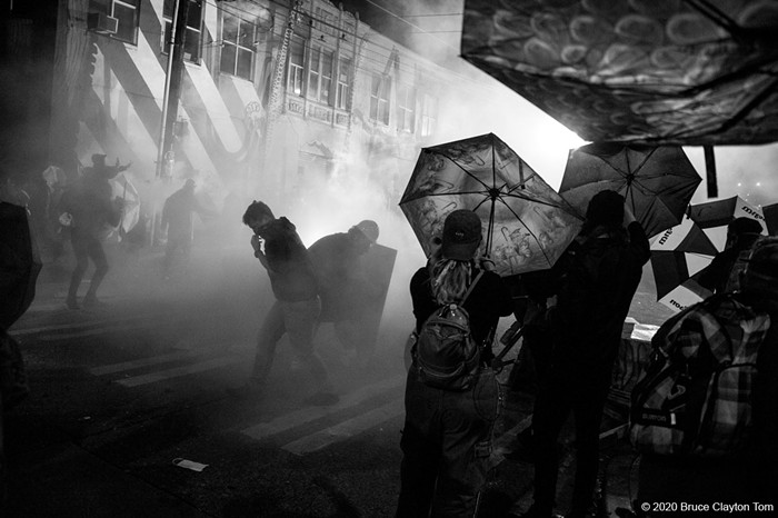 A cloud of tear gas billows over retreating protestors. Mayor Durkan and Police Chief Best had just stated at a press conference that tear gas would no longer be used. This was tear gas.