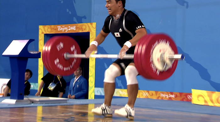 Athens silver medalist Lee Bae-Young, from South Korea, tore his left calf muscle during the mens 69kg weightlifting category at the 2008 Beijing Olympics. Somehow, he decides to do two more attempts after this. It doesnt end well.