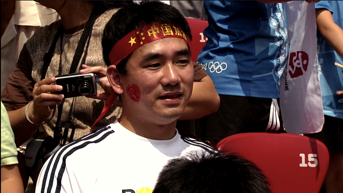 This guy in the crowd was the biggest Liu Xiang fan. I keep thinking of his stunned and dejected face after Liu quit the race due to an injury.