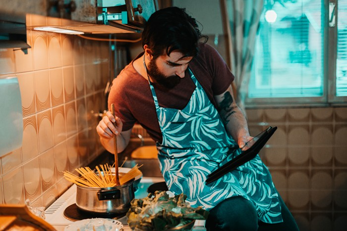 A portrait of the author cooking while stoned.