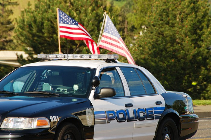 The US flag or a representation of it should be banned from cop cars. This is what deflation is about.