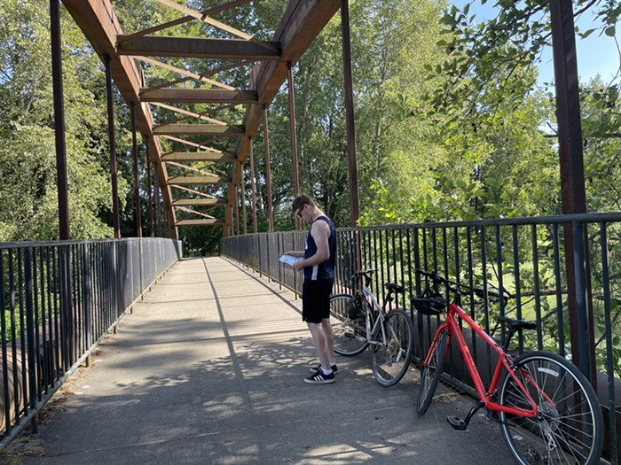 Please enjoy the best picture of the four I took during this ride: my boyfriend looking at the route map on a very lovely bridge in Tukwila.