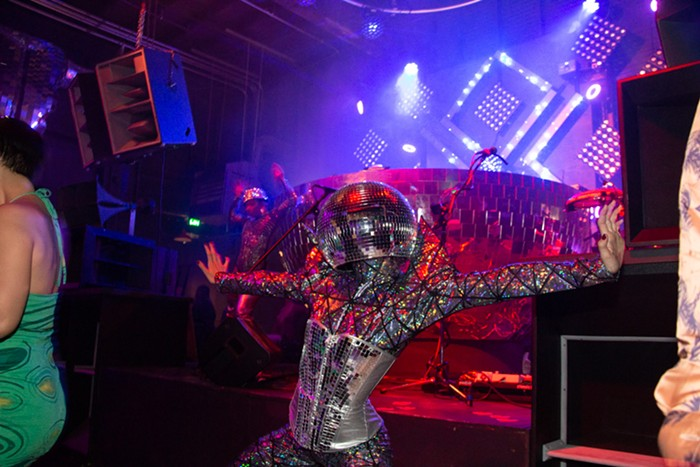 Downstairs next to the stage, these disco ball-headed go go dancers were really something else.