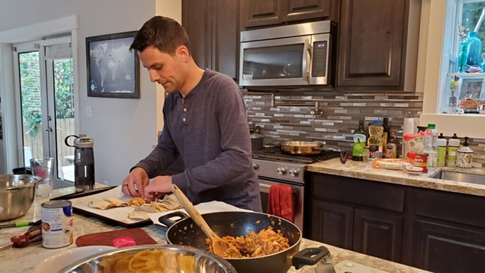 King County Council District 9 candidate Chris Franco making some tinga de pollo tacos.