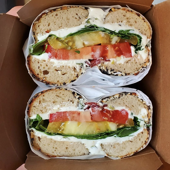 Make the most of tomato season with the Agnes, Agatha, Germain, and Jack (heirloom tomatoes, bacon, arugula, and scallion cream cheese) at Rachels Bagels & Burritos.