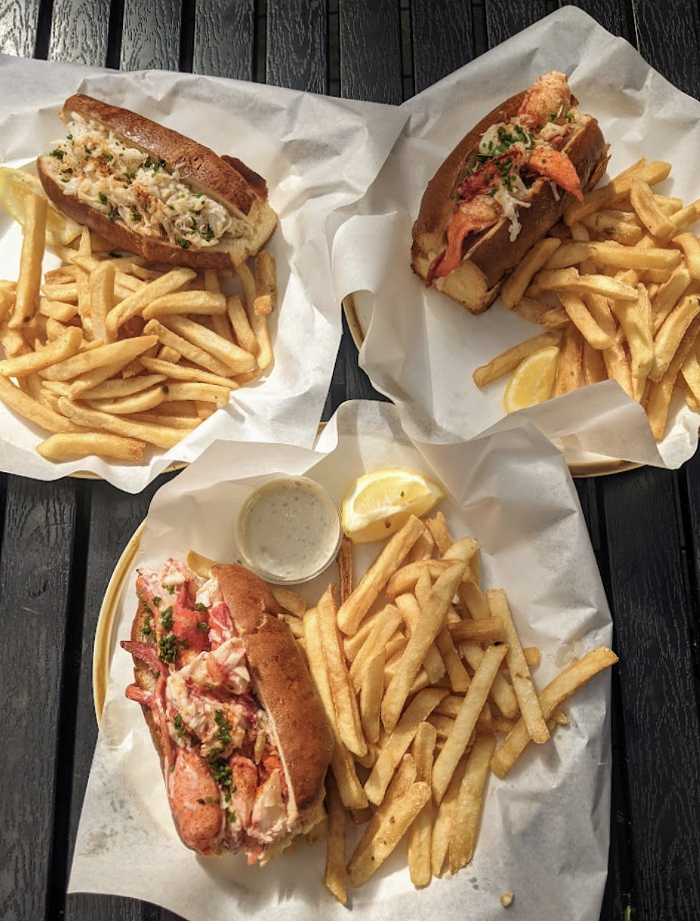 The holy trinity. Clockwise from top left: Dungeness crab roll, Connecticut-style lobster roll (warm with butter), Maine-style lobster roll (cold with mayo).
