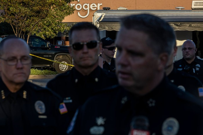 Collierville Police Chief Dale Lane (R) speaks with the media outside of a Kroger grocery store on September 23, 2021 in Collierville, Tennessee. The Kroger is where authorities said that a gunman had apparently killed himself after opening fire inside of the store killing one person and injuring 12 others.