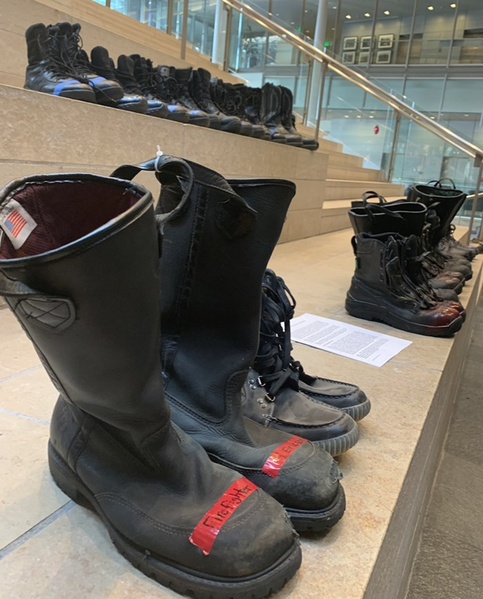 A dozen or so firefighters and cops walked into City Hall and left their boots on the steps after refusing to comply with the vaccine mandate.