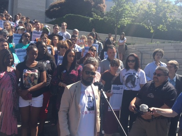 Andre Taylor, an organizer whose brother Che Taylor was shot by Seattle police, announces support for a new police accountability initiative on City Hall steps.