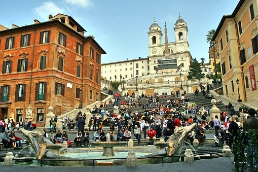 Romans and tourists sit on the Spanish Steps in Rome.