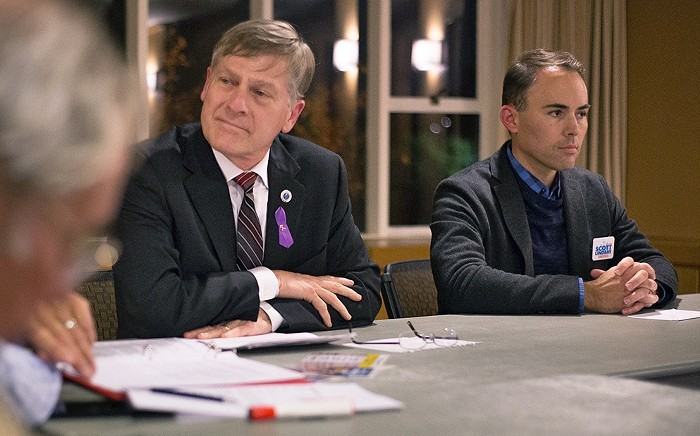 Thats Pete Holmes on the left. Hes sitting next to Scott Lindsay, who lost his race against Holmes by 50 points in 2017.