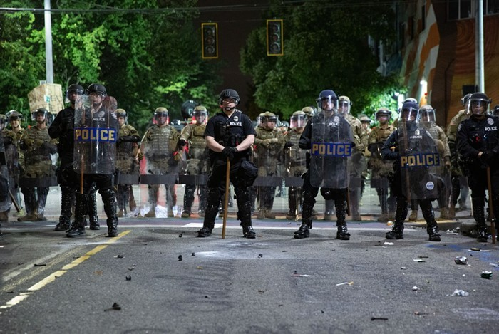 Police ready themselves on Capitol Hill in June of 2020.
